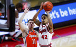 Rutgers guard Jacob Young (42) shoots next to Syracuse guard Joseph Girard III (11) during the second half of an NCAA college basketball game in Piscataway, N.J., Tuesday, Dec. 8, 2020. (AP Photo/Noah K. Murray)