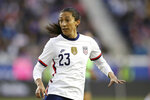 FILE - In this March 8, 2020, file photo, United States forward Christen Press (23) looks for a pass during the second half of a SheBelieves Cup soccer match against Spain, in Harrison, N.J. U.S. national team players Megan Rapinoe, Tobin Heath and Christen Press have opted out of the National Women's Soccer League tournament kicking off this weekend in Utah. Heath and Press, who played with Rapinoe on the champion World Cup team last summer in France, cited concerns about the coronavirus for their decisions not to play. (AP Photo/Steve Luciano, File)