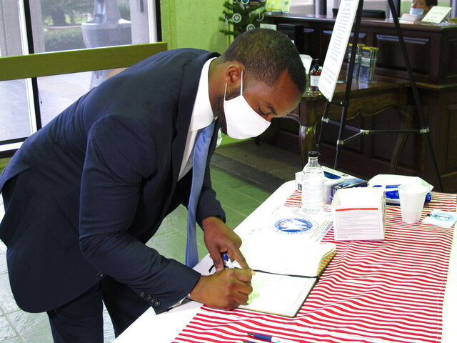 Shreveport Mayor Adrian Perkins, a Democrat, signs the registration book as he qualified for the U.S. Senate race, on Thursday, July 23, 2020, in Baton Rouge, La. Perkins is challenging Republican incumbent Bill Cassidy for the Senate seat. (AP Photo/Melinda Deslatte)