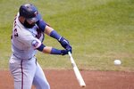 Minnesota Twins' Marwin Gonzalez hits an RBI double during the fourth inning of a baseball game against the Milwaukee Brewers Wednesday, Aug. 12, 2020, in Milwaukee. (AP Photo/Morry Gash)