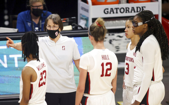 Stanford head coach Tara VanDerveer talks to her team during the second half of an NCAA college basketball game against UCLA in the Pac-12 women's tournament championship Sunday, March 7, 2021, in Las Vegas. (AP Photo/Isaac Brekken)
