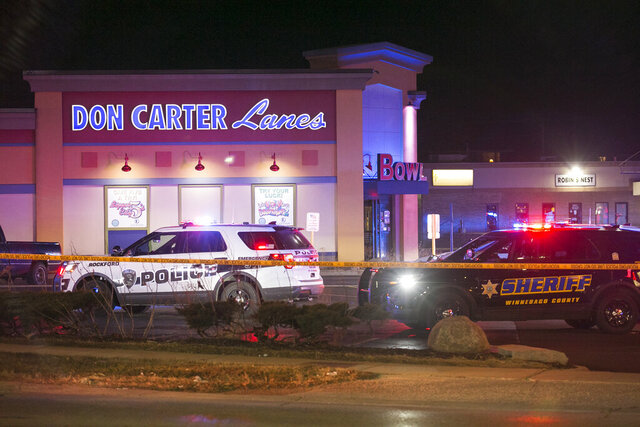 FILE - In this Dec. 26, 2020 file photo, Rockford police and other law enforcement agencies investigate the scene of a shooting at a bowling alley in Rockford, Ill. In Detroit, Chicago, New York, Philadelphia and even smaller Grand Rapids, Michigan, and Milwaukee, 2020 has been deadly not only because of the pandemic, but because gun violence is spiking. It is the same for other mid-sized cities. Last year, there were 18 homicides in Rockford, a city of about 170,000 people in northern Illinois. More than 30 have been killed so far this year, including three Saturday at a bowling alley. (Scott P. Yates/Rockford Register Star via AP)