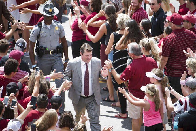 South Carolina head coach Will Muschamp leads the team on their walk into Williams Brice Stadium for an NCAA college football game against Georgia, Saturday, Sept. 8, 2018, in Columbia, S.C. (AP Photo/Sean Rayford)