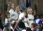 The bridesmaids and page boys, including Prince George and Princess Charlotte, arrive for the wedding of Princess Eugenie of York and Jack Brooksbank in St George's Chapel, Windsor Castle, near London, England, Friday Oct. 12, 2018. (Yui Mok, Pool via AP)