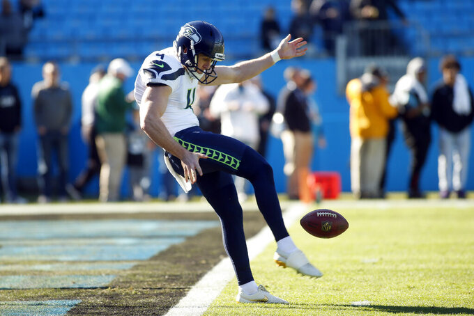 FILE - In this Dec. 15, 2019, file photo, Seattle Seahawks punter Michael Dickson (4) warms up before an NFL football game against the Carolina Panthers in Charlotte, N.C. Dickson is getting a long-term contract and a hefty payday after reaching agreement on a $14.5 million, four-year extension with the Seahawks, according to a person with knowledge of the deal. The person spoke to The Associated Press on Friday, June 4, 2021, on the condition of anonymity because the team had not announced the extension.   (AP Photo/Brian Blanco, File)