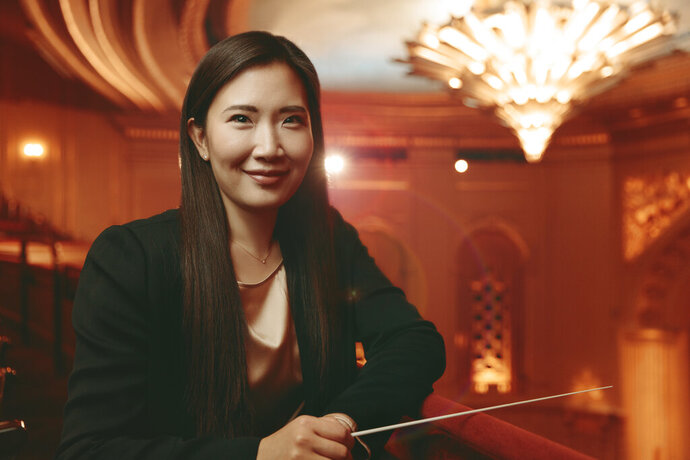 "This undated photo provided by the San Francisco Opera shows San Francisco Opera Music Director Designate Eun Sun Kim. The 39-year-old Kim will become the company's music director designate effective immediately and take on the position permanently in August, conducting Beethoven's ""Fidelio"" when the 2020-21 season opens, the company said Thursday.(Marc Olivier Le Blanc/San Francisco Opera via AP)"