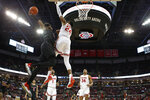 Rutgers' Myles Johnson, left, tries to dunk the ball over Ohio State's Andre Wesson during the second half of an NCAA college basketball game Wednesday, Feb. 12, 2020, in Columbus, Ohio. Ohio State beat Rutgers 72-66. (AP Photo/Jay LaPrete)