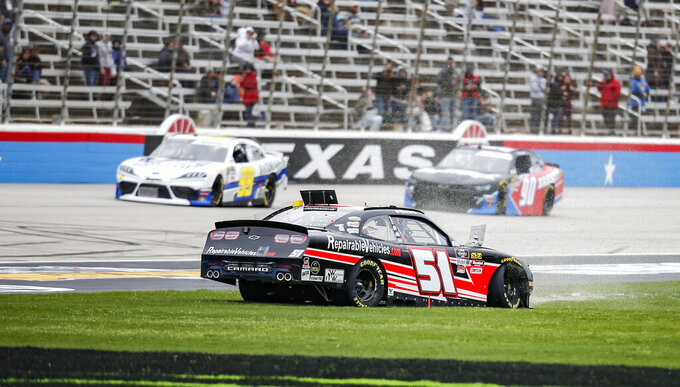 Driver Jeremy Clements spins out into the grass on the front stretch during a NASCAR auto race at Texas Motor Speedway, Saturday, March 30, 2019, in Fort Worth, Texas. (AP Photo/Brandon Wade)