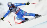 Italy's Dominik Paris speeds down the course during the men's super-G at the alpine ski World Championships in Are, Sweden, Wednesday, Feb. 6, 2019. (AP Photo/Gabriele Facciotti)