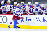 New York Rangers' Mika Zibanejad (93) celebrates with teammates after scoring a goal during the second period of an NHL hockey game against the Philadelphia Flyers, Thursday, March 25, 2021, in Philadelphia. (AP Photo/Matt Slocum)