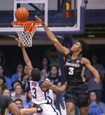 Providence guard David Duke (3) attempts to block the shot of Butler guard Kamar Baldwin (3) during the second half of an NCAA college basketball game, Tuesday, Feb. 26, 2019, in Indianapolis. Providence won 73-67. (AP Photo/Doug McSchooler)
