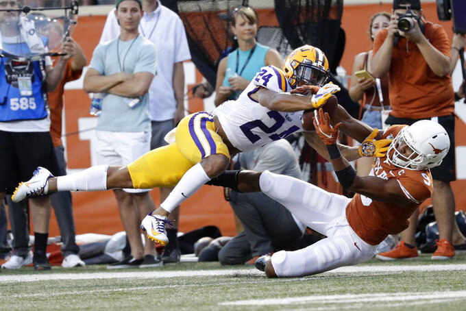 FILE - In this Sept. 7, 2019, file photo, LSU cornerback Derek Stingley Jr., left, breaks up a pass intended for Texas wide receiver Collin Johnson during the first half of an NCAA college football game, in Austin, Texas. Stingley was selected to the AP Midseason All-America NCAA college football team, Tuesday, Oct. 15, 2019. (AP Photo/Eric Gay, File)