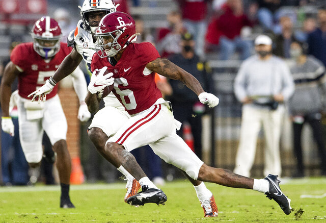 Alabama wide receiver DeVonta Smith (6) breaks free for a touchdown against Auburn during an NCAA college football game Saturday, Nov. 28, 2020, in Tuscaloosa, Ala. (Mickey Welsh/The Montgomery Advertiser via AP)