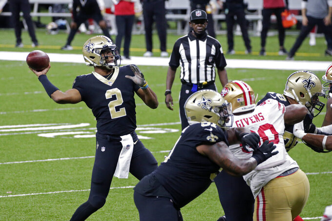 New Orleans Saints quarterback Jameis Winston (2) passes in the second half of an NFL football game against the San Francisco 49ers in New Orleans, Sunday, Nov. 15, 2020. (AP Photo/Butch Dill)