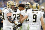 New Orleans Saints wide receiver Michael Thomas, center, celebrates with teammates after scoring a touchdown on a 2-yard pass reception against the Tennessee Titans in the second half of an NFL football game Sunday, Dec. 22, 2019, in Nashville, Tenn. The Saints won 38-28. (AP Photo/James Kenney)