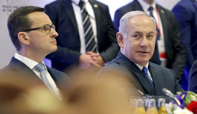 File -- In this Thursday, Feb. 14, 2019 photo Poland's Prime Minister Mateusz Morawiecki, left, and Israeli Prime Minister Benjamin Netanyahu, right, attend a meeting in Warsaw, Poland. Poland's prime minister canceled plans for his country to send a delegation to meeting in Jerusalem on Monday after the acting Israeli foreign minister Israel Katz said that Poles