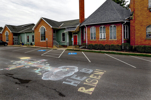 The finished chalk drawing that Kelly Casey, and her daughter Ellen Casey, drew in the parking lot Saturday, is seen outside of the Calvin Presbyterian Church, on Easter Sunday, April 12, 2020, in Zelienople, Pa. Parishioners were not attending the church for the Easter services that were being streamed on the internet because of the concern of spreading the coronavirus. (AP Photo/Keith Srakocic)