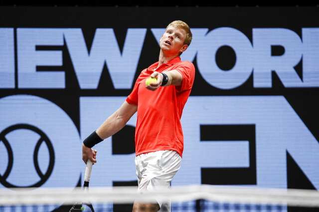 Kyle Edmund, of Britain, serves to Miomir Kecmanovic, of Serbia, during his semifinal match at the New York Open tennis tournament, Saturday, Feb. 15, 2020, in Uniondale, NY. (AP Photo/John Minchillo)