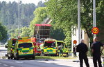 Rescue personnel at a block of flats that were hit by an explosion, in Linkoping, Sweden, Friday,  June 7, 2019. A blast ripped through two adjacent apartment buildings in a southern Sweden city on Friday, police said. There were unconfirmed reports of people with minor injuries. (Jeppe Gustafsson/TT News Agency via AP)