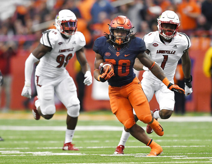 Syracuse running back Jarveon Howard carries the ball against Louisville during the second half of an NCAA college football game in Syracuse, N.Y., Friday, Nov. 9, 2018. (AP Photo/Adrian Kraus)