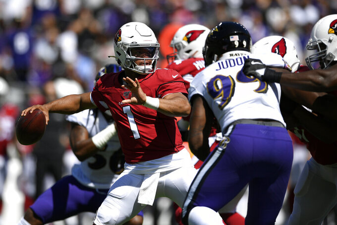 Arizona Cardinals quarterback Kyler Murray (1) throws to a receiver in the first half of an NFL football game against the Baltimore Ravens, Sunday, Sept. 15, 2019, in Baltimore. (AP Photo/Nick Wass)