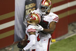 San Francisco 49ers cornerback Jason Verrett, foreground, celebrates after intercepting a pass against the Los Angeles Rams during the second half of an NFL football game in Santa Clara, Calif., Sunday, Oct. 18, 2020. (AP Photo/Jed Jacobsohn)