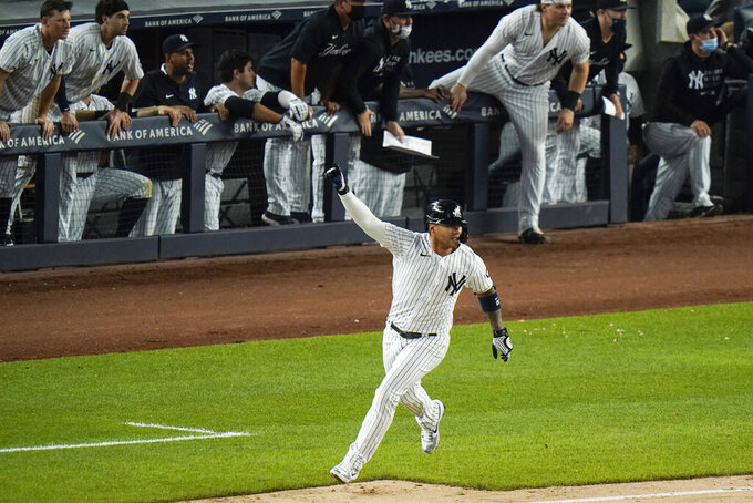 New York Yankees' Gleyber Torres celebrates after hitting an RBI-single to drive in the winning run during the ninth inning of a baseball game against the Chicago White Sox, Friday, May 21, 2021, in New York. The Yankees won 2-1. (AP Photo/Frank Franklin II)