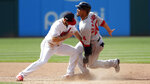 Cleveland Indians' Jason Kipnis, left, tags out Boston Red Sox's Marco Hernandez on a steal to second base in the eighth inning in a baseball game, Wednesday, Aug. 14, 2019, in Cleveland. The Red Sox won 5-1. (AP Photo/Tony Dejak)