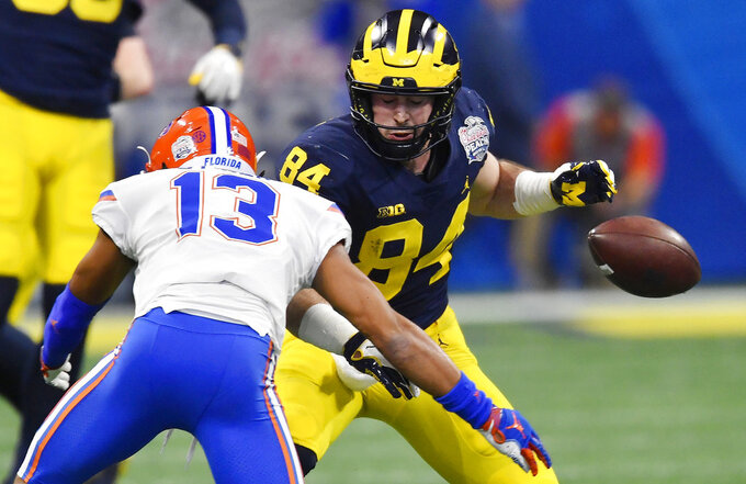 Michigan tight end Sean McKeon (84) misses a catch against Florida safety Donovan Stiner (13) during the first half of the Peach Bowl NCAA college football game, Saturday, Dec. 29, 2018, in Atlanta. (AP Photo/Mike Stewart)