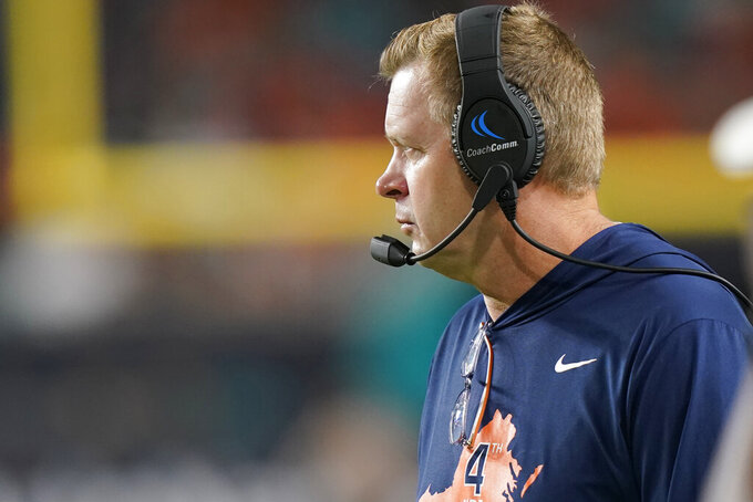 Virginia Cavaliers head coach Bronco Mendenhall watches the game from the sidelines during the second half of a NCAA college football game against Miami, Thursday, Sept. 30, 2021, in Miami Gardens, Fla. (AP Photo/Lynne Sladky)