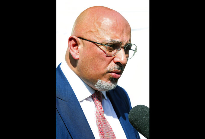 FILE - In this Wednesday, July 24, 2019 file photo, Britain's Conservative Party Member of Parliament Nadhim Zahawi is interviewed by the media at the College Green, in central London. Britain's vaccines minister has dismissed suggestions that the country was getting key COVID-19 jabs intended for poorer countries, insisting that 10 million doses coming from India were always intended for distribution in the U.K. Zahawi, in an interview with The Associated Press on Friday, March 5, 2021 confirmed reports that the Serum Institute of India, one of the world's largest vaccine makers, would be sending doses of the vaccine developed by Oxford University and AstraZeneca to the U.K. (AP Photo/Vudi Xhymshiti, file)