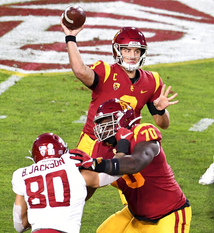 Southern California quarterback Kedon Slovis (9) passes against Washington State in the first half of an NCAA college football game in Los Angeles, Sunday, Dec. 6, 2020. (Keith Birmingham/The Orange County Register via AP)