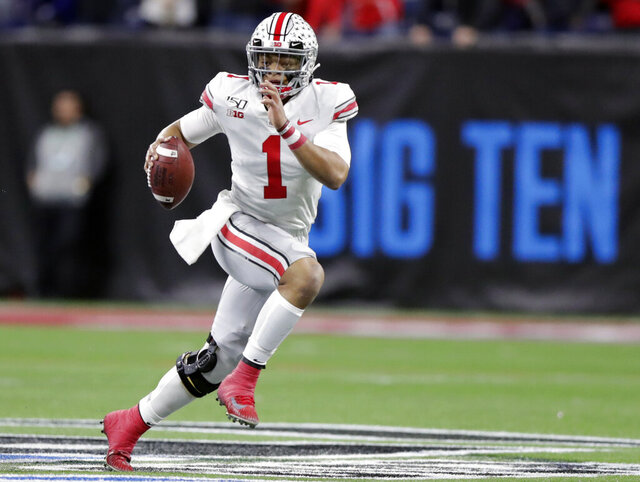 FILE - In this Dec. 7, 2019, file photo, Ohio State quarterback Justin Fields (1) runs with the ball against Wisconsin during the first half of the Big Ten championship NCAA college football game, in Indianapolis. The Big Ten won't play football this fall because of concerns about COVID-19, becoming the first of college sports' power conferences to yield to the pandemic. The move announced Tuesday, Aug. 11, 2020, comes six day after the conference that includes historic programs such as Ohio State, Michigan, Nebraska and Penn State had released a revised conference-only schedule that it hoped would help it navigate a fall season with potential COVID-19 disruptions. (AP Photo/Michael Conroy, File)
