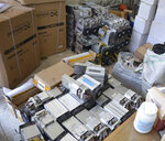 This undated photo provided by the Police News Agency, shows boxes of machinery used in Bitcoin