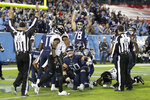 Tennessee Titans players celebrate after a 7-yard touchdown run by running back Derrick Henry against the Jacksonville Jaguars in the second half of an NFL football game Sunday, Nov. 24, 2019, in Nashville, Tenn. (AP Photo/James Kenney)