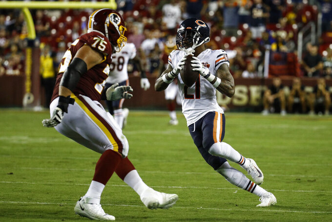 Chicago Bears strong safety Ha Ha Clinton-Dix (21) runs with his interception in front of Washington Redskins offensive guard Brandon Scherff (75) during the second half of an NFL football game Monday, Sept. 23, 2019, in Landover, Md. (AP Photo/Patrick Semansky)