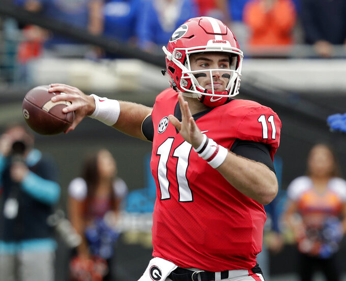 FILE - In this Oct. 27, 2018, file photo, Georgia quarterback Jake Fromm (11) throws a pass against Florida during the first half of an NCAA college football game, in Jacksonville, Fla. No. 5 Georgia has completed its SEC schedule and now must avoid looking ahead to its SEC championship game against No. 1 Alabama as it finishes its regular season with nonconference games against UMass on Saturday and state rival Georgia Tech the following week. (AP Photo/John Raoux, File)