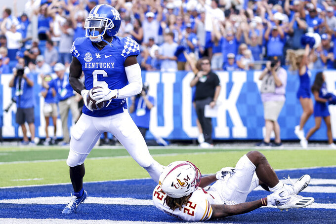Kentucky wide receiver Josh Ali (6) scores a touchdown during the first half of an NCAA college football game against Louisiana-Monroe in Lexington, Ky., Saturday, Sept. 4, 2021. (AP Photo/Michael Clubb)