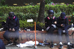 Protesters rest at Hong Kong Polytechnic University after police stormed part of the campus during the early morning hours in Hong Kong, Monday, Nov. 18, 2019. Police breached the university campus held by protesters early Monday after an all-night siege that included firing repeated barrages of tear gas and water cannons. (AP Photo/Vincent Yu)