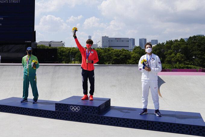 From left, bronze medalist Kelvin Hoefler of Brazil, gold medalist Yuto Horigome of Japan and bronze winner Jagger Eton stand on the podium after the men's street skateboarding finals at the 2020 Summer Olympics, Sunday, July 25, 2021, in Tokyo, Japan. (AP Photo/Ben Curtis)
