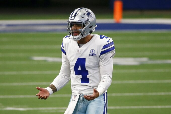 Dallas Cowboys quarterback Dak Prescott (4) talks to an official standing nearby in the first half of an NFL football game against the Atlanta Falcons in Arlington, Texas, Sunday, Sept. 20, 2020. (AP Photo/Ron Jenkins)