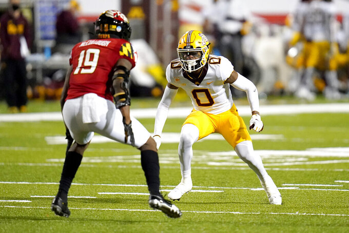 Minnesota wide receiver Rashod Bateman (0) runs a route against Maryland linebacker Ahmad McCullough (19) during the first half of an NCAA college football game, Friday, Oct. 30, 2020, in College Park, Md. (AP Photo/Julio Cortez)