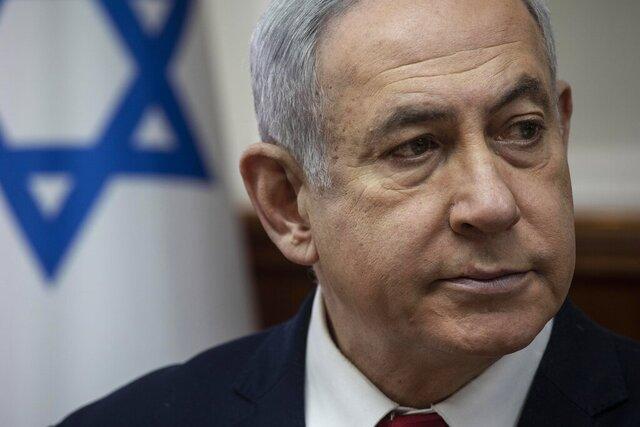 Israeli Prime Minister Benjamin Netanyahu attends the weekly cabinet meeting at the Prime Minister's office in Jerusalem, Sunday, Jan. 12, 2020. (AP Photo/Tsafrir Abayov, Poo)
