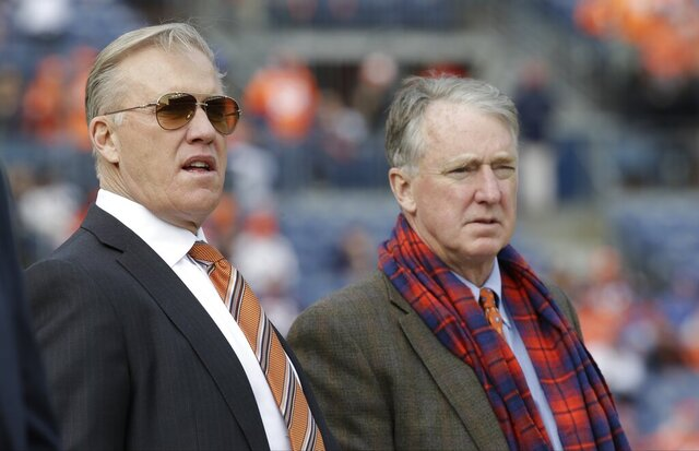 FILE  - In this Jan. 1, 2017, file photo, Denver Broncos general manager John Elway, left, stands with Broncos President and CEO Joe Ellis before an NFL football game against the Oakland Raiders in Denver. The Denver Broncos say that general manager John Elway and team president Joe Ellis have tested positive for COVID-19. Both were informed Tuesday, Nov. 3 of positive tests. (AP Photo/Jack Dempsey, File)