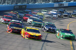 Joey Logano (22) leads the field through Turn 4 during a NASCAR Cup Series auto race at ISM Raceway, Sunday, Nov. 10, 2019, in Avondale, Ariz. (AP Photo/Ralph Freso)
