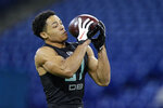 Penn State defensive back John Reid runs a drill at the NFL football scouting combine in Indianapolis, Sunday, March 1, 2020. (AP Photo/Michael Conroy)
