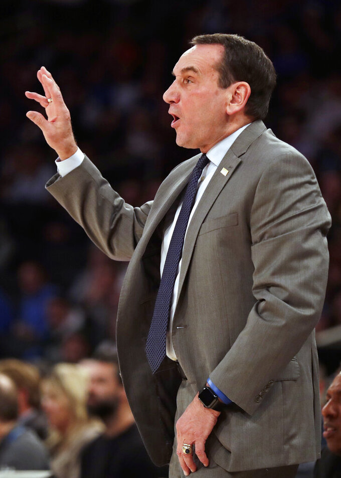 Duke coach Mike Krzyzewski directs his team against Kansas during the first half of an NCAA college basketball game Tuesday, Nov. 5, 2019, in New York. (AP Photo/Adam Hunger)