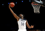 United States' Myles Turner drives to the basket during their exhibition basketball game against Australia in Melbourne, Thursday, Aug. 22, 2019. (AP Photo/Andy Brownbill)