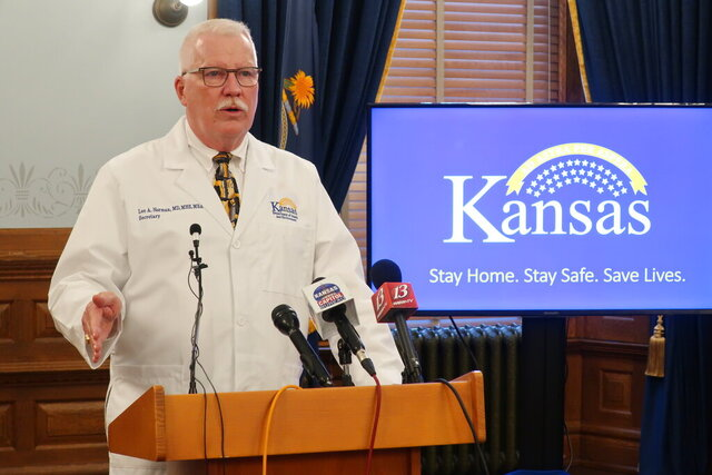 Dr. Lee Norman, the Kansas Department of Health and Environment's top administrator, answers questions about the coronavirus pandemic during a news conference Friday, May 29, 2020, at the Statehouse in Topeka, Kan. Norman says he would have preferred that Gov. Laura Kelly had not lifted statewide restrictions on businesses. (AP Photo/John Hanna)