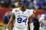 FILE - Air Force defensive tackle Jordan Jackson (94) looks on in the first half during the Cheez-It Bowl NCAA college football game against Washington State in Phoenix, in this Friday, Dec. 27, 2019, file photo. A cadet is allowed to take up to two semesters away from the Academy. One of those was Air Force defensive lineman Jordan Jackson, who took the time to heal from a shoulder injury. With Jackson among those back in the mix, the Falcons may resemble the 2019 squad that went 11-2 more than the team that finished 3-3 in a virus-truncated 2020 season. (AP Photo/Rick Scuteri, File)